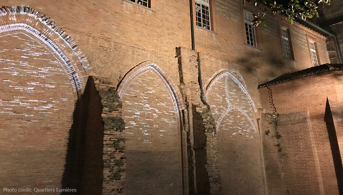 Gobo projections highlight the architectural details on the gothic façade.