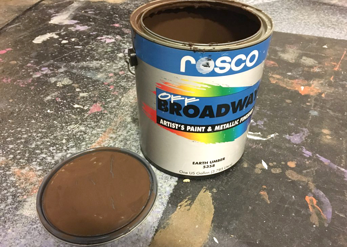 Open can of Earth Umber paint.