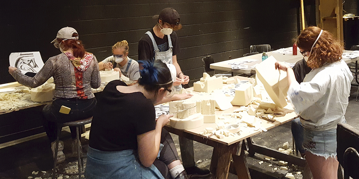 Students prepare for foam carving.