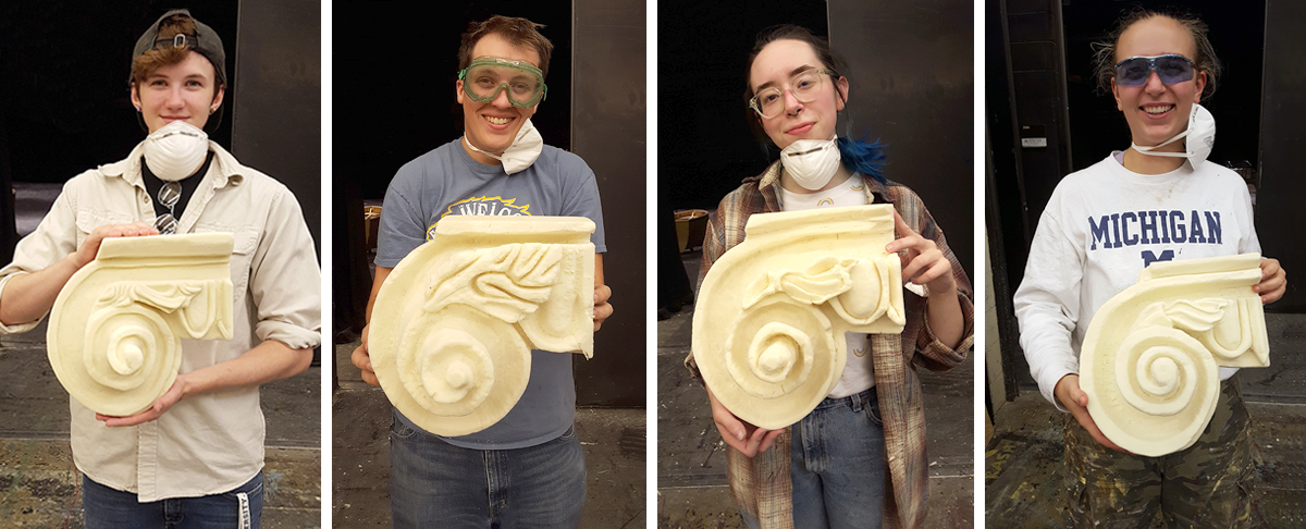 Four students hold their Ionic Capitals props.