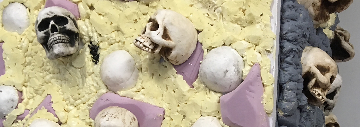 Prep for creepy Halloween scenery using insulation foam carved to look like rocks and pre-painted skulls.