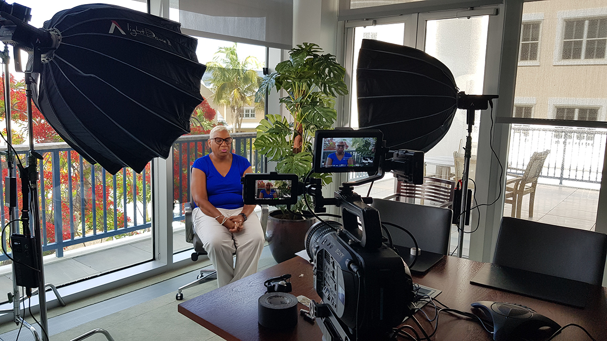 Lighting setup featuring Roscoscrim on the windows during a corporate video shoot.