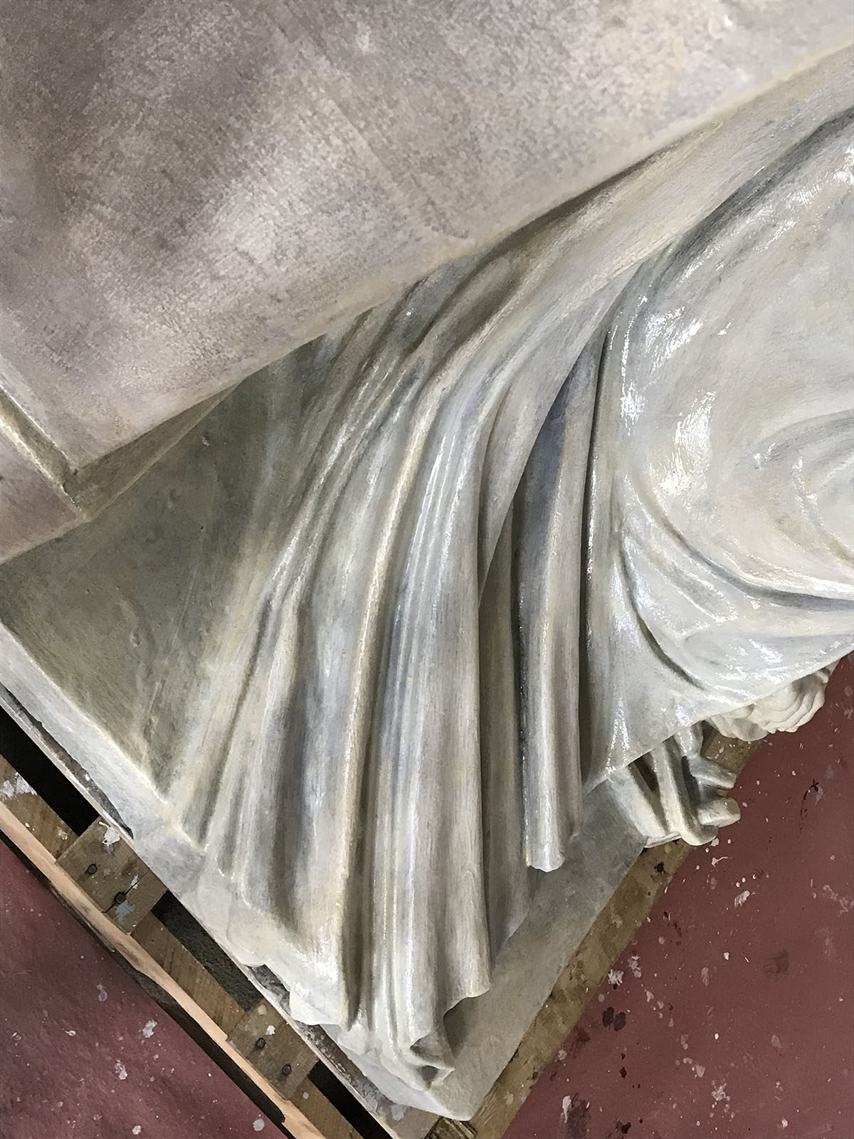 The statue's folds are accentuated with Rosco Off-Broadway paint and Premiere Clear Gloss.